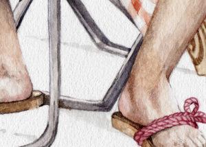 Chancleta en el pie de un hombre sujetado con un gordon rosa
